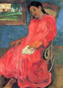 A picture of a woman in a red dress, sitting in a chair.