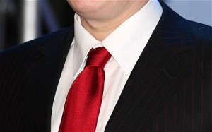 Picture of a man wearing a red tie.