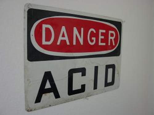 A sign that says Danger Acid