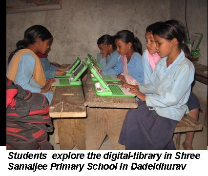 Children using a cheap high accessibility laptop.