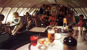 People in business class on a Qantas plane in the 70s.