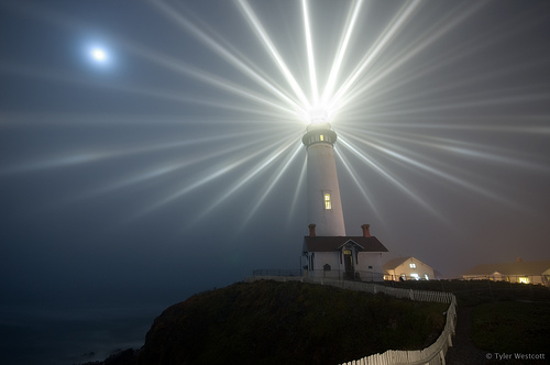 Pigeon point lighthouse, with star-like rays emanating from the light.