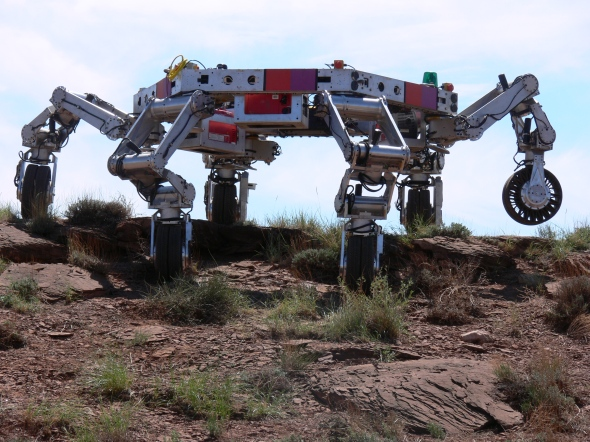 This robot is the business at climbing hills. Dancing like a fool, not so much. It's not human.
