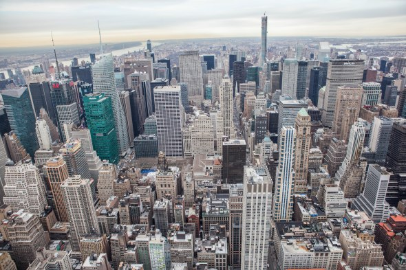 Aerial perspective photo of a lot of tall buildings in midtown Manhattan, facing north to Central Park.